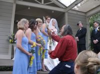 The smoke from white sage blesses the bride's maids.