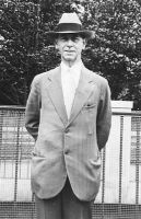 Ed Penrose outside in relaxed suit